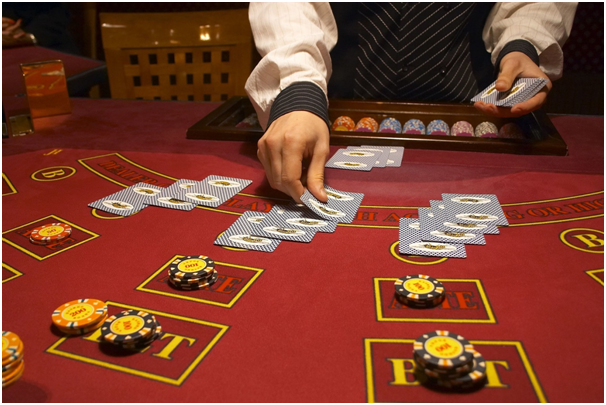 What gives the dealer an advantage in blackjack?